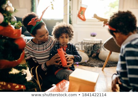 Small girl wrapping Christmas gifts at home Stock photo © ozgur