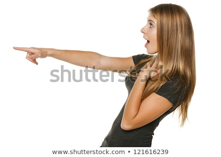 Young astonished woman standing with surprised hands gesture Stock photo © deandrobot