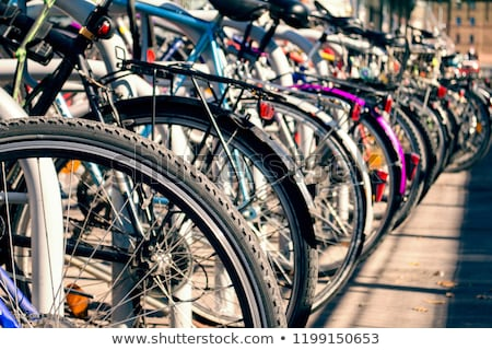 Stock photo: Bicycles parked in a row next to the road