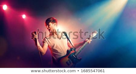 fiatal · gitáros · előad · teljes · alakos · kép · gitáros - stock fotó © wavebreak_media