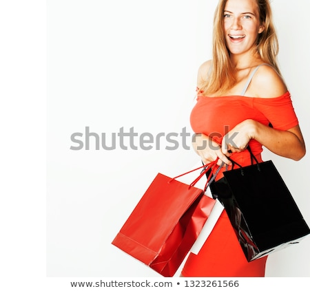 young modern blond woman with diverse bags posing emotional on white background sale lifestyle pe stock photo © iordani