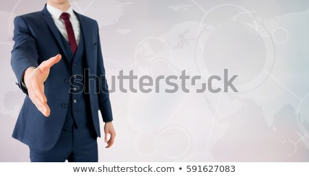 Caucasian businessman with outstretched hand. Stock photo © RAStudio