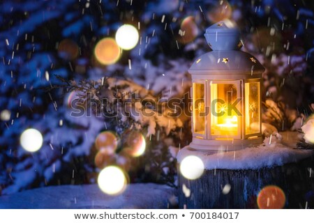 Christmas lantern in snow with holly Stock photo © RTimages