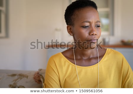 sad young casual woman looking down  Stock photo © feedough