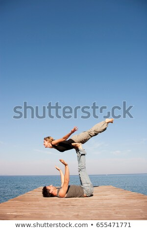 Couple Playing Air Plain On Pier Stock photo © IS2