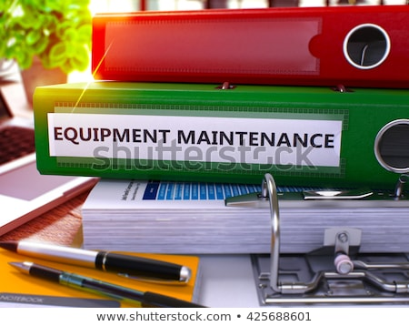 Green Ring Binder with Inscription Equipment Maintenance. Stock photo © tashatuvango