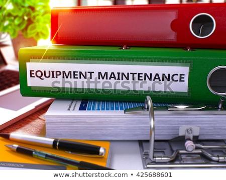 green ring binder with inscription equipment maintenance stock photo © tashatuvango