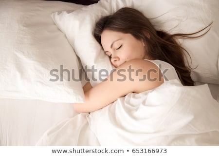 Stock photo: View at attractive woman in the bed