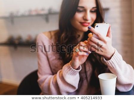 Kép mosolygó nő sms chat mobiltelefon ül kint Stock fotó © deandrobot