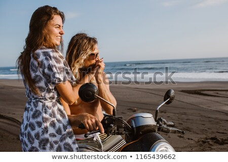 Couple sitting on scooter together Stock photo © IS2