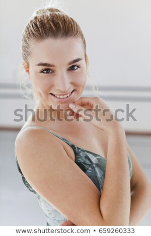 Uśmiechnięty baletnica dotknąć podbródek kobieta szczęścia Zdjęcia stock © IS2