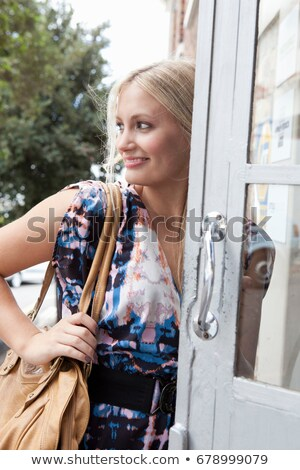 Woman carrying large purse in doorway Stock photo © IS2