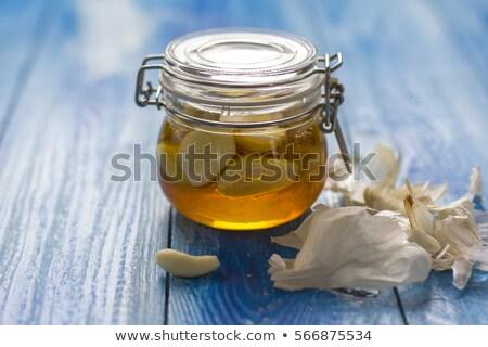 ginger tea with honey, citrus and garlic on wood Stock photo © dolgachov