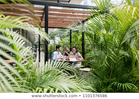 People sitting down outdoors at a modern cafeteria in Asia Stock photo © Kzenon