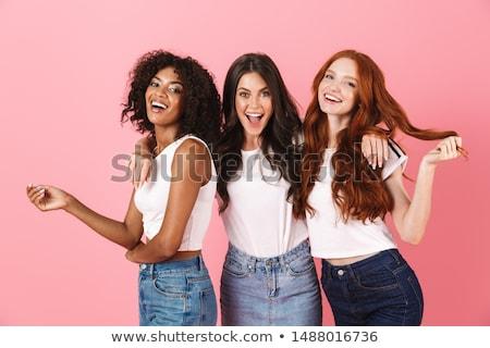 Aranyos fiatal nők barátok pózol izolált rózsaszín Stock fotó © deandrobot