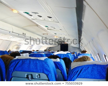 Interior comercial avião passageiros homem trabalhar Foto stock © lightpoet
