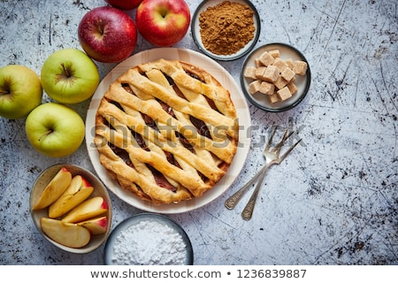 Delicious apple pie cake with a fresh fruits, brown and powder sugar Stock photo © dash