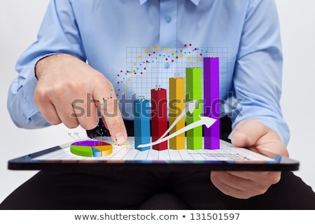 hand working in tablet graphs and charts and reports concept aro stock photo © ra2studio