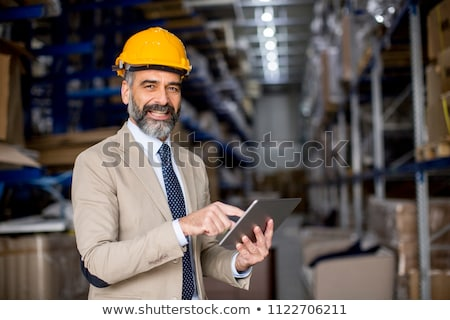 Middle-aged businessman with digital tablet in factory Stock photo © boggy