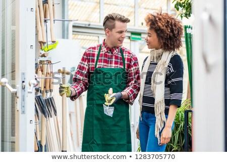 Jóképű munkás segít vásárló választ kertészkedés Stock fotó © Kzenon