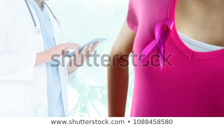 3d doctor standing with pink breast cancer ribbon stock photo © nasirkhan