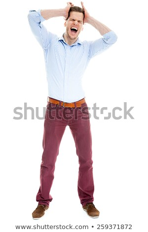 displeased young businessman pulls his tie Stock photo © feedough