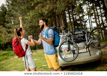 Young couple with trekking outfit standing in the forest Stock photo © boggy