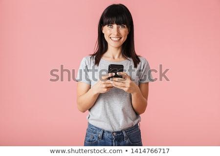 Mooie verbazingwekkend jonge vrouw poseren geïsoleerd roze Stockfoto © deandrobot