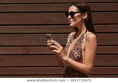 Mooie vrouw zonnebril poseren geïsoleerd Stockfoto © deandrobot