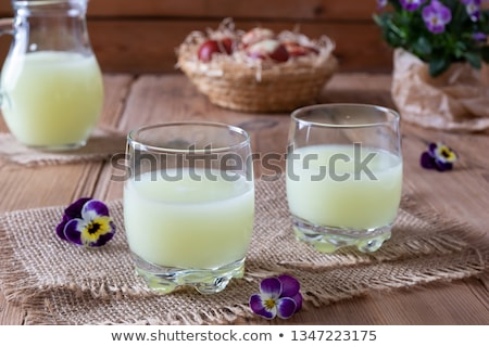 two glasses of fresh whey with pansy flowers stock photo © madeleine_steinbach