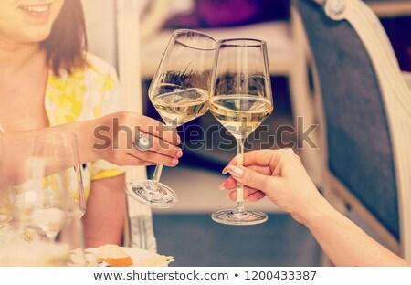 Cam beyaz şarap kadın el yalıtılmış kadın Stok fotoğraf © OleksandrO