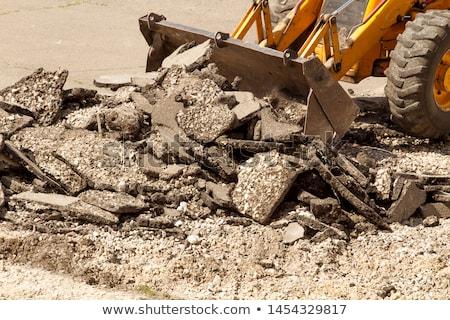 Traktor aszfalt citromsárga kotrógép ásatás vödör Stock fotó © leedsn