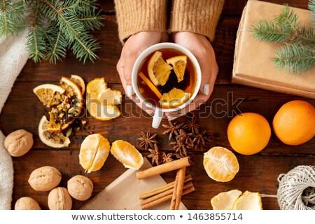 Felső kilátás aromás tea narancs szeletek Stock fotó © pressmaster