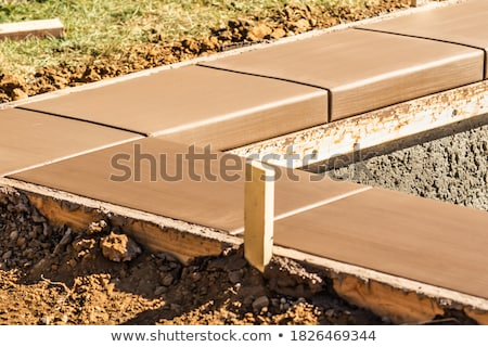 Fresh Pool Coping Cement Drying Within Wood Framing Stock photo © feverpitch