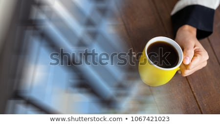 White coffee cup and blurry office transition Stock photo © wavebreak_media