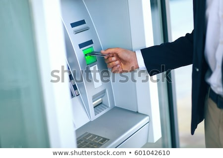 Person Using Card To Withdraw Money From ATM Machine Stock photo © AndreyPopov