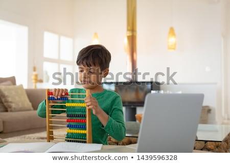 Elöl kilátás aranyos afroamerikai fiú tanul Stock fotó © wavebreak_media