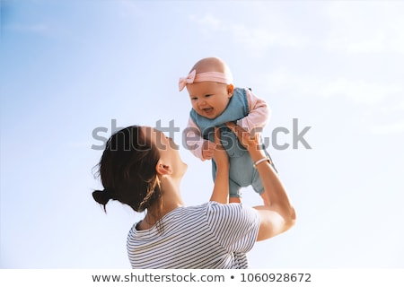 Mother and baby daughter at the beach Stock photo © dashapetrenko