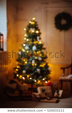 Beautiful wrapped box under decorated Christmas tree. Festive ev Stock photo © vkstudio