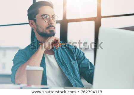 Indoor shot of serious thoughtful man drinks takeaway coffee, wears protective mask, transparent gla Stock photo © vkstudio