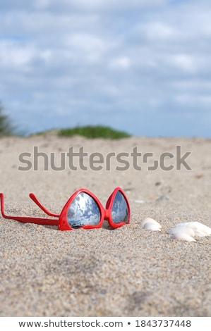 Сток-фото: Heart Shaped Sunglasses And Shells On Beach Sand