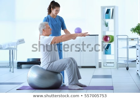 Rehabilitación terapia ejercicio hombro lesión hombre Foto stock © AndreyPopov
