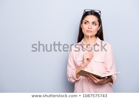 Stock photo: woman portrait with pencil and notepad
