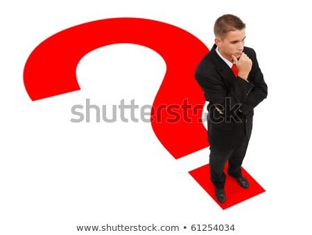 Empresário em pé pontos de interrogação ponto pensando negócio Foto stock © dacasdo