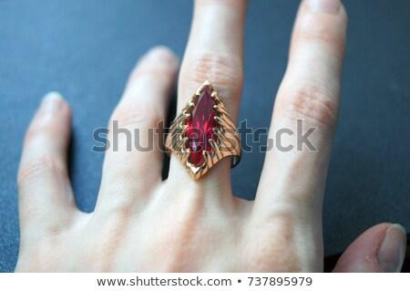 Mulher mão rubi pulseira vermelho linhas Foto stock © Dahlia