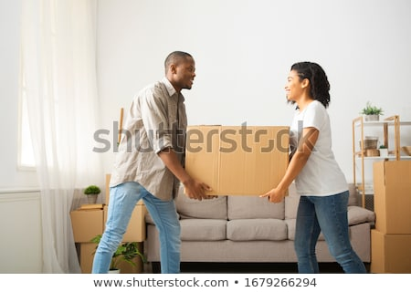 Couple carrying boxes and house plant stock photo © photography33