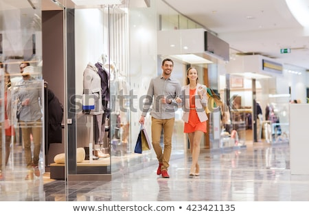 Couple shopping in mall Stock photo © photocreo