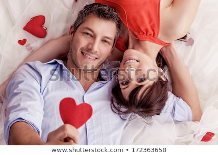 Man in bed with rose Stock photo © curaphotography