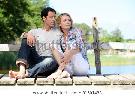Couple relaxing on a pontoon Stock photo © photography33