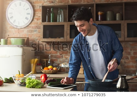 Stock photo: young man cooking